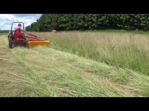 John Deere 755 with hay mowers and hay rake