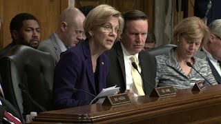 Warren challenges Trump
