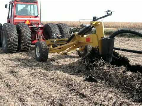 Installing Prinsco farm drainage tile  with the Gold Digger tile plow