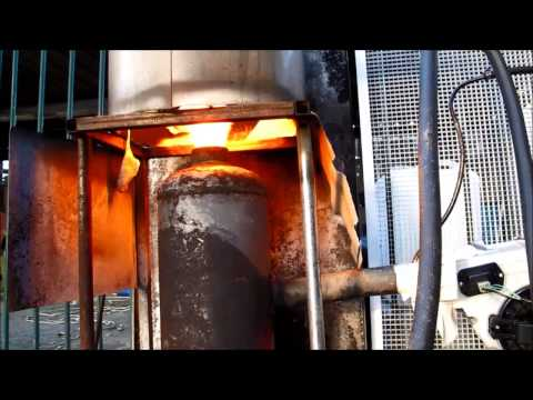 Using waste oil to heat domestic hot water system