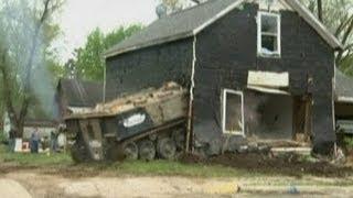 Tank drives through house in Minnesota