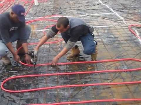 Installing PEX tubing for infloor radiant heating with a PEX Gun.