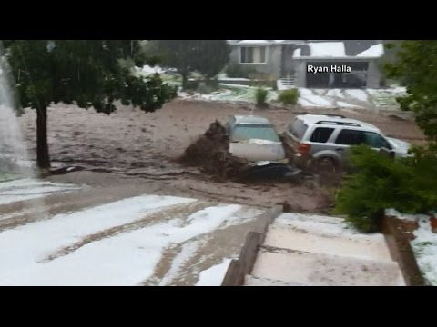 Floodwaters carry away cars in Colorado
