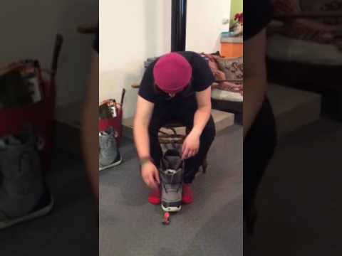 The correct way of putting a snowboard boot on