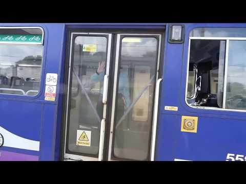 15.59 train to Morecambe departs Carnforth BR Railway Station Lancs UK