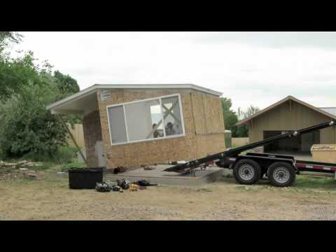 Installing a solar greenhouse & chicken coop. Check out this trailer!