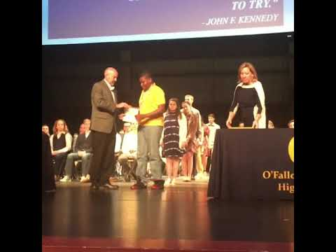 My son receiving an award for earning $164k in scholarships