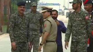 Indian soldiers offer sweets to Pakistani counterparts on 71st Independence Day