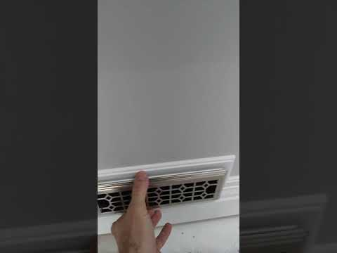 Installing baseboard around floor heater and duct registers