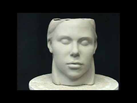 Ceramic sculpture. Sculpting a head in pottery clay. Pottery to Art.