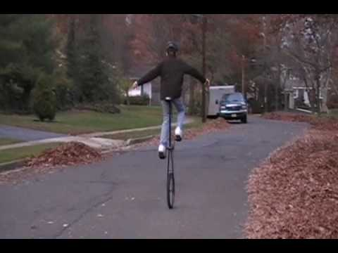 12 year old boy rides a 5 foot unicycle