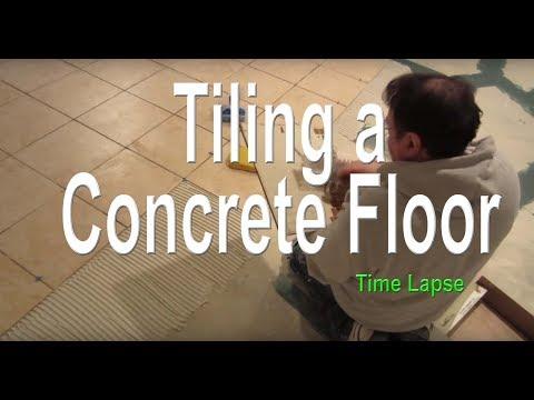 Tile installation of a concrete  basement floor, time lapse