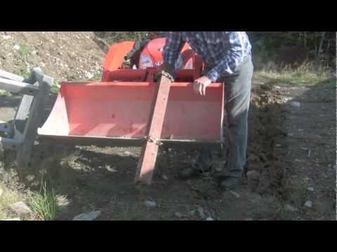 Homemade trencher for tractor bucket on Kubota BX