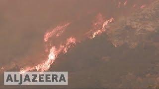 Santa Barbara threatened as California fires rages on