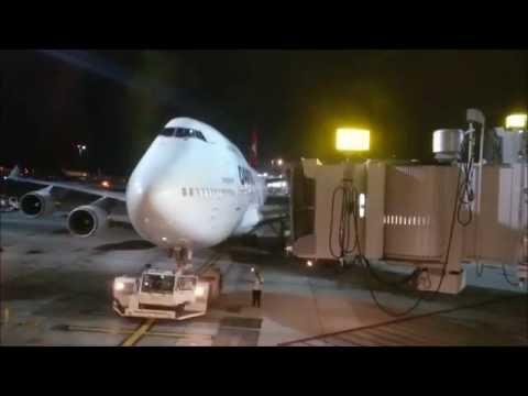 Qantas flight QF16 departing from LAX at night.