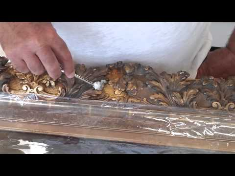 Professionally cleaning a gilded frame