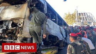 Deadly bomb blasts hit Syria military bus - BBC News