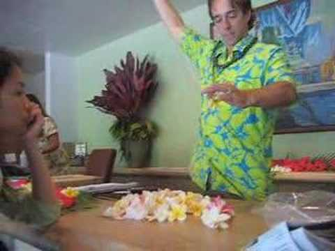 Hei making a lei from plumeria flowers at Hana Hotel