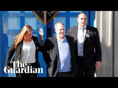 Harvey Weinstein in handcuffs outside New York police station
