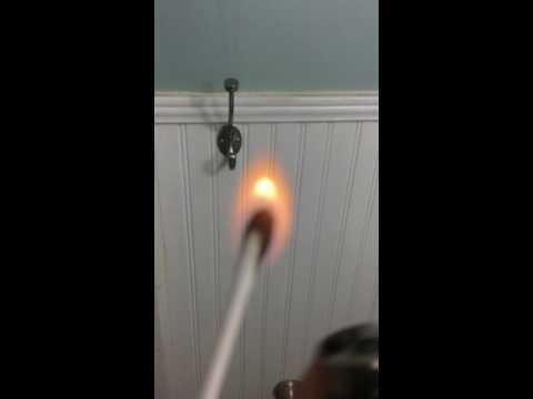 Burning a q-tip