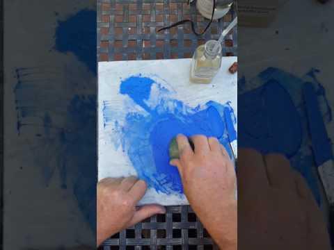 Making cobalt blue watercolor paint.