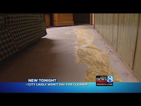Residents stuck with sewage backup bill