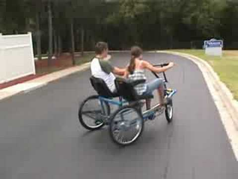 Team dual trike, is a side by side, three wheel tricycle.