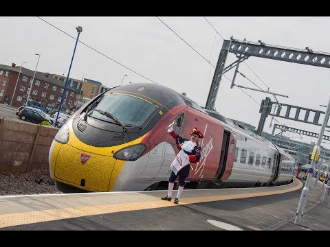390042 departs Blackpool North with the first revenue earning ''Pendolino'' service to Euston