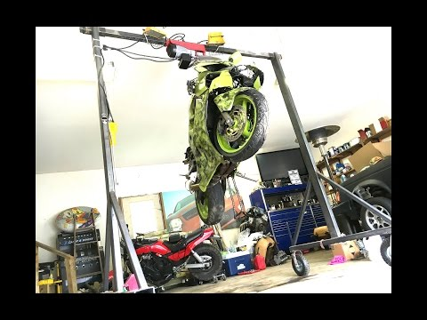 Homemade hoist lifting a motorcycle