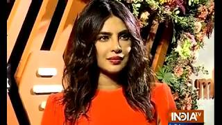 Priyanka Chopra stuns in tangerine look at Mumbai event