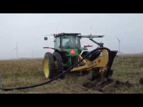 Installing drainage tile with Soilmax ZD tile plow and Intellislope
