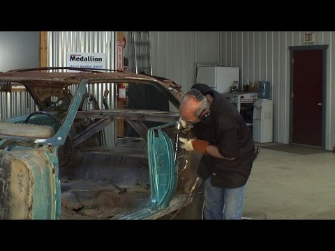USING A CHISEL TO STRIP METAL FROM A CAR BODY