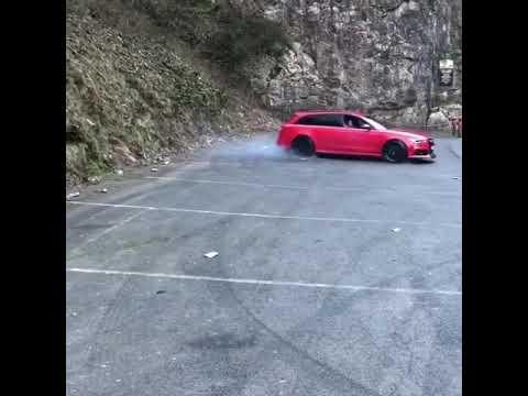 Audi Q7 drifting hard on a road