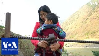 Villagers in southwest China hang on for dear life to cross rivers on ziplines