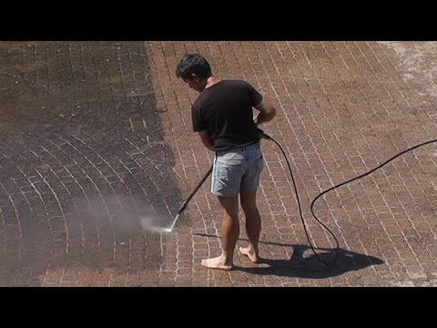 Time-lapse block paving cleaning with pressure washer