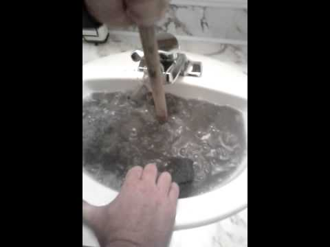 Unclogging a bathroom sink