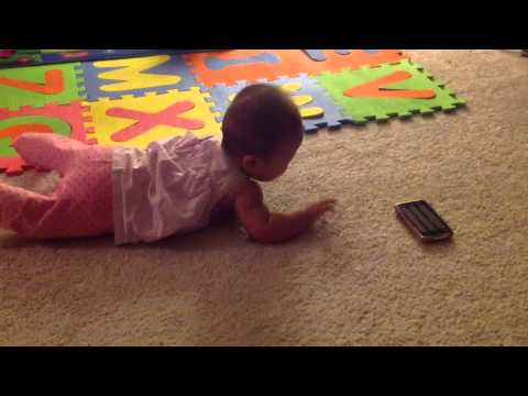 Baby reaching for object - commando crawl