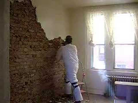 Removing plaster and exposing brick in a South Philly rowhouse