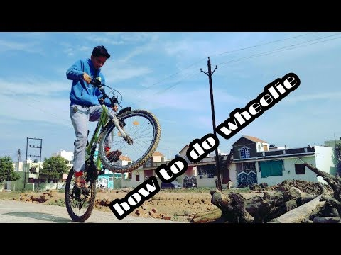 how to do wheelie in hindi