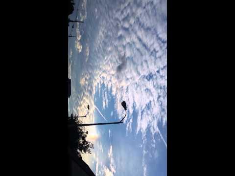 Strange rainbow clouds black clouds haarp? North Jersey