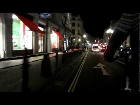 Driving down Regent Street in London from Piccadilly Circus with Bicycle Taxi by Night