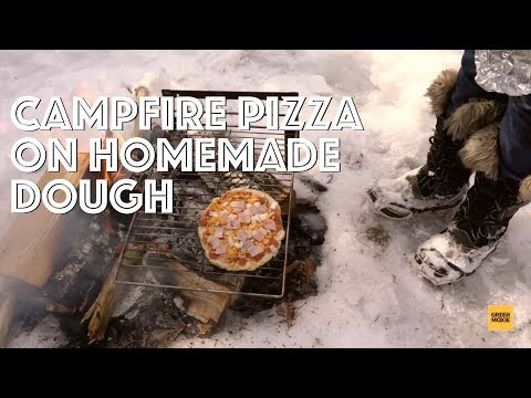Grilled pizza with homemade dough on the campfire