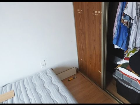 how to remove sliding closet door from bottom track (plastic guides)