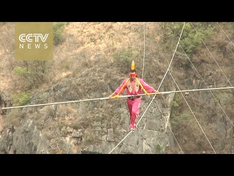 Chinese tightrope artist completes daring blindfolded walk