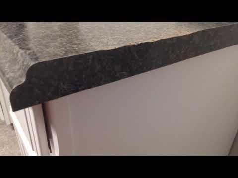How to trim a laminate countertop edge.