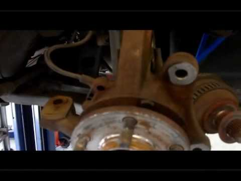PT Cruiser front wheel bearing replacement.wmv