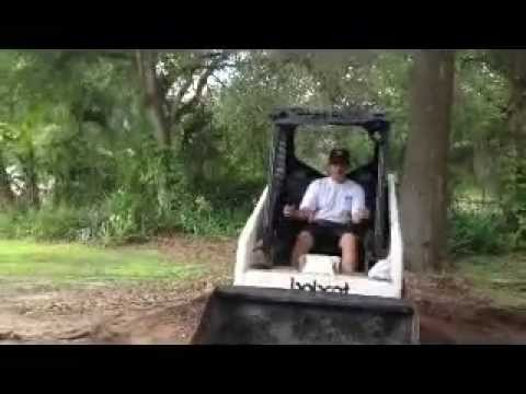 Alex's first time operating the Bobcat