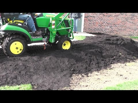 Bury Some Dirt - Deere 1025R Roll out the new carpet (sod) (Part 3)