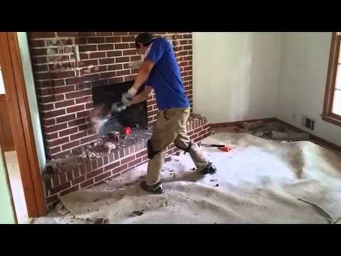 Ryo using a sledge hammer on the fireplace