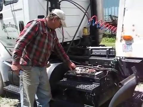 Farmer shows how to deal with semi truck batteries